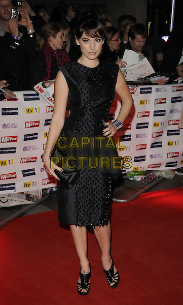 KELLY BROOK.The Pride Of Britain Awards 2009, Grosvenor House, London, England..October 5th 2009.arrivals full length black beaded sleeveless peplum grey gray dress shoes lace-up booties clutch bag peep toe patent hand on hip.CAP/CAN.©Can Nguyen/Capital Pictures.