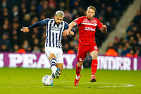 29th December 2019; The Hawthorns, West Bromwich, West Midlands, England; English Championship Football, West Bromwich Albion versus Middlesbrough; Charlie Austin of West Bromwich Albion runs under pressure from Adam Clayton of Middlesbrough - Strictly Editorial Use Only. No use with unauthorized audio, video, data, fixture lists, club/league logos or 'live' services. Online in-match use limited to 120 images, no video emulation. No use in betting, games or single club/league/player publications