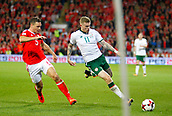 9th October 2017, Cardiff City Stadium, Cardiff, Wales; FIFA World Cup Qualification, Wales versus Republic of Ireland; James McClean (Republic of Ireland) gets to the ball ahead of James Chester (Wales)