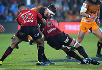 Jaguares' Marcos Kremer is tackled during the 2019 Super Rugby final between the Crusaders and Jaguares at Orangetheory Stadium in Christchurch, New Zealand on Saturday, 6 July 2019. Photo: Dave Lintott / lintottphoto.co.nz