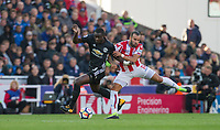 Eric Bailly of Man Utd battles Jese of Stoke City during the Premier League match between Stoke City and Manchester United at the Britannia Stadium, Stoke-on-Trent, England on 9 September 2017. Photo by Andy Rowland.