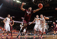 Virginia Tech forward Joey Van Zegeren (2) reaches for the rebound during the game Tuesday in Charlottesville, VA. Virginia defeated Virginia Tech73-55.