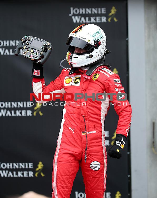 26.08.2018, Circuit de Spa-Francorchamps, Spa-Franchorchamps, FORMULA 1 2018 JOHNNIE WALKER BELGIAN GRAND PRIX, 23. - 26.08.2018<br /> , im Bild<br />Sieger Sebastian Vettel (GER#5), Scuderia Ferrari steht auf seinem Auto und feiert den Sieg<br /> Foto © nordphoto / Bratic