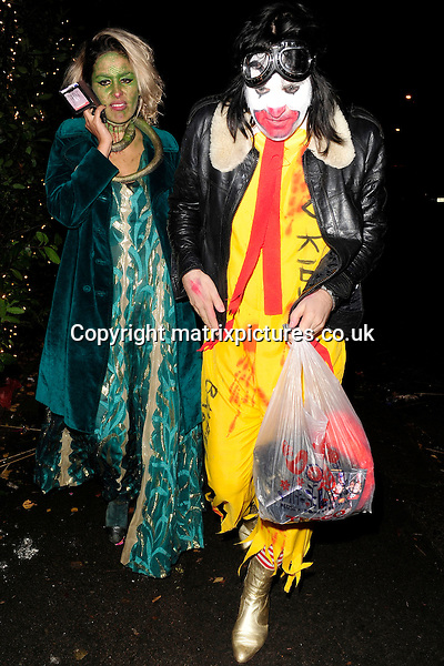 NON EXCLUSIVE PICTURE: MATRIXPICTURES.CO.UK<br /> PLEASE CREDIT ALL USES<br /> <br /> WORLD RIGHTS<br /> <br /> English comedian Noel Fielding attending Jonathan Ross' annual Halloween party at his North London home.<br /> <br /> OCTOBER 31st 2013<br /> <br /> REF: ASI 137101