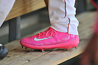 Catcher Austin Rei (13) of the Greenville Drive wears special pink Nike cleats for Mother's Day in a game against the Columbia Fireflies on Sunday, May 8, 2016, at Fluor Field at the West End in Greenville, South Carolina. Greenville won, 5-4. (Tom Priddy/Four Seam Images)