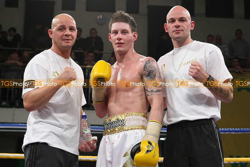 Liam Shinkwin (white shorts) defeats Robin Deakin in a Lightweight boxing contest at York Hall, Bethnal Green, promoted by Frank Warren - 21/10/11 - MANDATORY CREDIT: Gavin Ellis/TGSPHOTO - Self billing applies where appropriate - 0845 094 6026 - contact@tgsphoto.co.uk - NO UNPAID USE