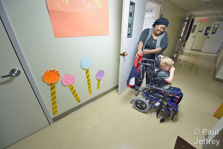 Kristen Dacres pushes the wheelchair of a student with developmental disabilities in the school at Lover's Lane United Methodist Church in Dallas, Texas. Dacres is assistant director of the school.