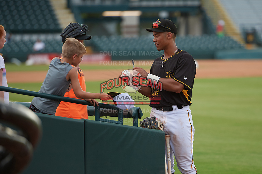 Bradenton Marauders Cal Mitchell (34) signs autographs after a Florida State League game against the Palm Beach Cardinals on May 10, 2019 at LECOM Park in Bradenton, Florida.  Bradenton defeated Palm Beach 5-1.  (Mike Janes/Four Seam Images)