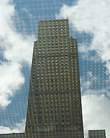 AVAILABLE FOR LICENSING FROM WWW.PLAINPICTURE.COM.  Please go to www.plainpicture.com and search for image # p5690244.<br /> <br /> Rockefeller Center - 30 Rockefeller Plaza (The GE Building) Reflected in a Window of 1251 Avenue of the Americas (Built as the Exxon Building), Midtown Manhattan, New York City, New York State, USA