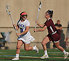Caitlin Breglia #9 of Long Beach, left, gets pressured by Madalyn Conklin #9 of North Shore during the Nassau County varsity girls lacrosse Class B quarterfinals at Long Beach High School on Thursday, May 19, 2016. Breglia scored the game-winner in overtime to lead Long Beach to a 9-8 victory.