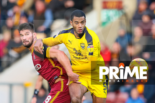 Kai Bruenker of Bradford City and Curtis Nelson of Oxford during the Sky Bet League 1 match between Bradford City and Oxford United at the Northern Commercial Stadium, Bradford, England on 24 November 2018. Photo by Thomas Gadd.