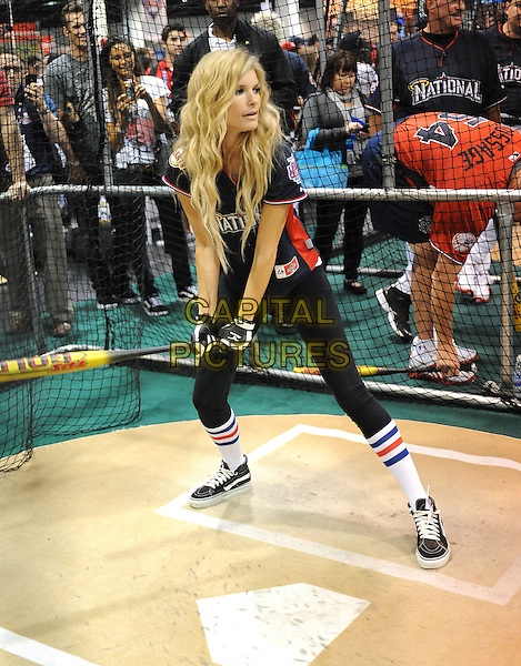 MARISA MILLER .At the MLB All Star Fanfest Batting Practice held at The Anaheim Convention Center , the precursor to The All Star Legends Celebrity Softball game in Anaheim, California, USA..July 11th, 2010.full length blue black top baseball batting cage bat swinging gesture leggings batting cage      .CAP/RKE/DVS.©DVS/RockinExposures/Capital Pictures.