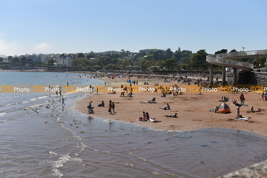 People enjoying the warm weather on Torre Abbey Sands beach in Torquay during the COVID-19 pandemic and lockdown