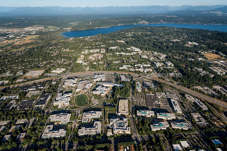 9/5/2012--Redmond, WA, USA..Microsoft's campus in Redmond, WA. View is from the west, looking east with Lake Sammamish and the Cascade Mountains in the background...Microsoft initially moved onto the grounds of the campus on February 26, 1986, weeks before the company went public on March 13. The headquarters has since experienced multiple expansions since its establishment...It is estimated to encompass over 8 million ft2 (750,000 m2) of office space and 30,000-40,000 employees. Additional offices are located in nearby Bellevue and Issaquah  and the company has about 90,000 employees world-wide...©2012 Stuart Isett. All rights reserve.