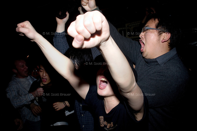 Punk fans scream from the audience during a punk concert at Castle Bar in Nanjing, China.