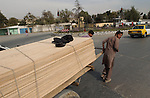 Kabul, Afghanistan; October 21, 2002 -- Men transport wooden panels, pulling their cart; people, labour, infrastructure -- Photo: © HorstWagner.eu