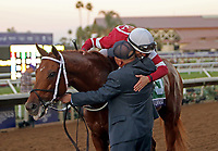 DEL MAR, CA - NOVEMBER 04: Florent Geroux, aboard Gun Runner #5, is congratulated by Scott Blasi after winning the Breeders' Cup Classic race on Day 2 of the 2017 Breeders' Cup World Championships at Del Mar Racing Club on November 4, 2017 in Del Mar, California. (Photo by Sue Kawczynski/Eclipse Sportswire/Breeders Cup)