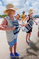A large crowd gathered on the white sands of Bonita Beach to hold hands and form a line that stretched along the Gulf of Mexico to protest off-shore drilling, Bonita Beach, Florida, USA. Photo by Debi Pittman Wilkey