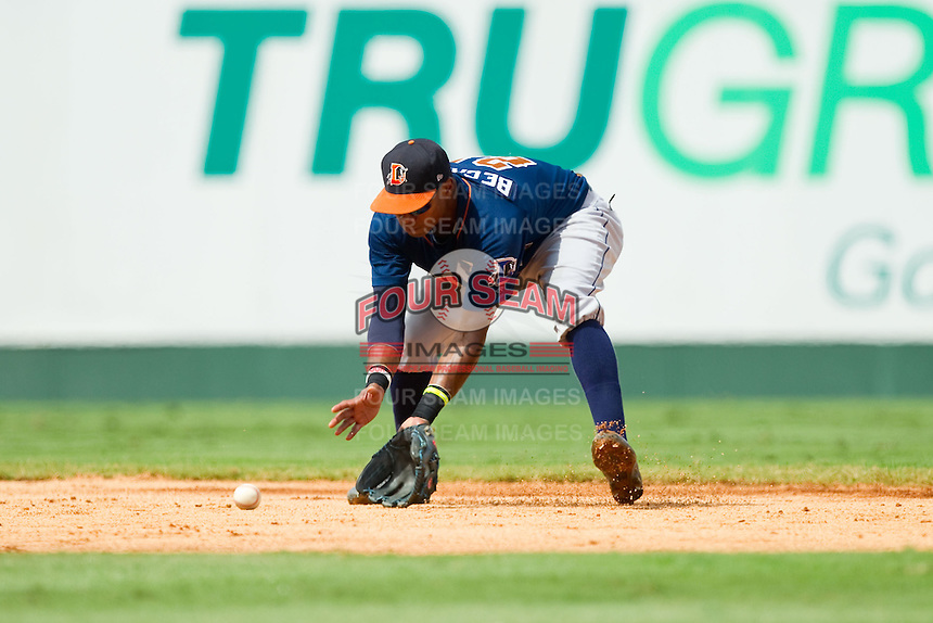 Durham Bulls shortstop Tim Beckham (22) fields a ground ball against the Charlotte Knights at Knights Stadium on August 18, 2013 in Fort Mill, South Carolina.  The Bulls defeated the Knights 8-5 in Game One of a double-header.  (Brian Westerholt/Four Seam Images)