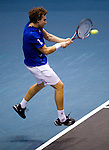BANGKOK, THAILAND - OCTOBER 01:  Ernets Gulbis of Latvia returns a ball to Guillermo Garcia-Lopez of Spain during the Day 7 of the PTT Thailand Open at Impact Arena on October 1, 2010 in Bangkok, Thailand. Photo by Victor Fraile / The Power of Sport Images