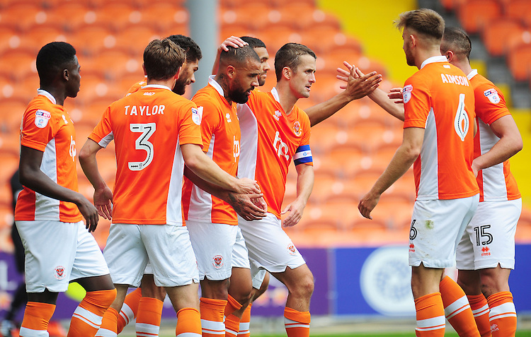 Blackpool's Kyle Vassell (centre) celebrates scoring his sides first goal with team-mates<br /> <br /> Photographer Kevin Barnes/CameraSport<br /> <br /> Football - The EFL Sky Bet League Two - Blackpool v Exeter City - Saturday 6th August 2016 - Bloomfield Road - Blackpool<br /> <br /> World Copyright © 2016 CameraSport. All rights reserved. 43 Linden Ave. Countesthorpe. Leicester. England. LE8 5PG - Tel: +44 (0) 116 277 4147 - admin@camerasport.com - www.camerasport.com