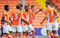 Blackpool's Kyle Vassell (centre) celebrates scoring his sides first goal with team-mates<br /> <br /> Photographer Kevin Barnes/CameraSport<br /> <br /> Football - The EFL Sky Bet League Two - Blackpool v Exeter City - Saturday 6th August 2016 - Bloomfield Road - Blackpool<br /> <br /> World Copyright &copy; 2016 CameraSport. All rights reserved. 43 Linden Ave. Countesthorpe. Leicester. England. LE8 5PG - Tel: +44 (0) 116 277 4147 - admin@camerasport.com - www.camerasport.com