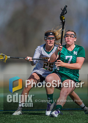 30 March 2016: Manhattan College Jasper Attacker Molly Fitzpatrick, a Freshman from Yorktown NY, maintains possession over University of Vermont Catamount Defender Avery Hogarth, a Freshman from Mississauga, Ontario, during game action at Virtue Field in Burlington, Vermont. The Lady Cats defeated the Jaspers 11-5 in non-conference play. Mandatory Credit: Ed Wolfstein Photo *** RAW (NEF) Image File Available ***