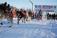 Saturday, February 24th, Knik, Alaska.  Jr. Iditarod musher Matthew Durden leaves start line on Knik Lake