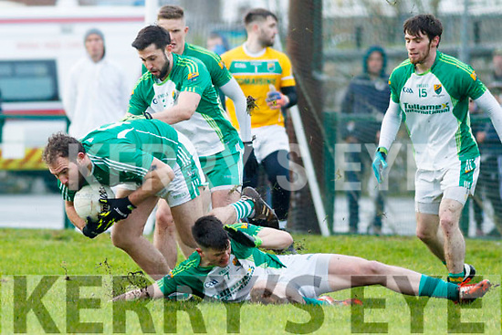 Mikey Boyle of Ballyduff under pressure from Ballydonoghue's Stephen Lonergan, Jason Foley and Jack Gogarty in the North Kerry football final.