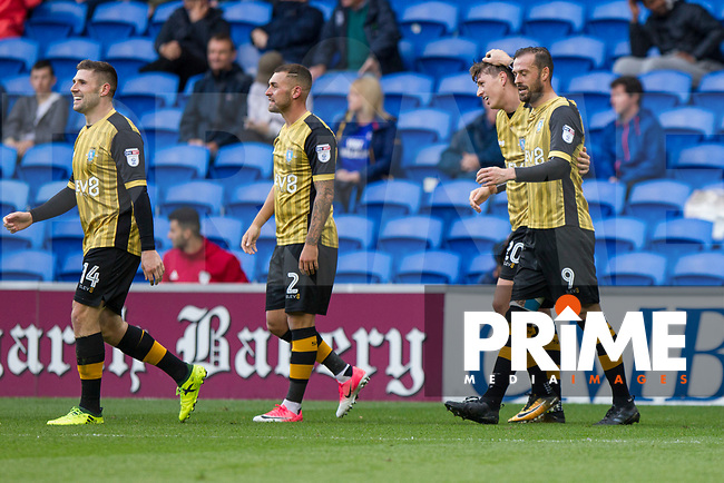 Gary Hooper of Sheffield Wednesday (far left) celebrates scoring his side's opening goal during the Sky Bet Championship match between Cardiff City and Sheffield Wednesday at Cardiff City Stadium, Cardiff, Wales on 16 September 2017. Photo by Mark  Hawkins / PRiME Media Images.