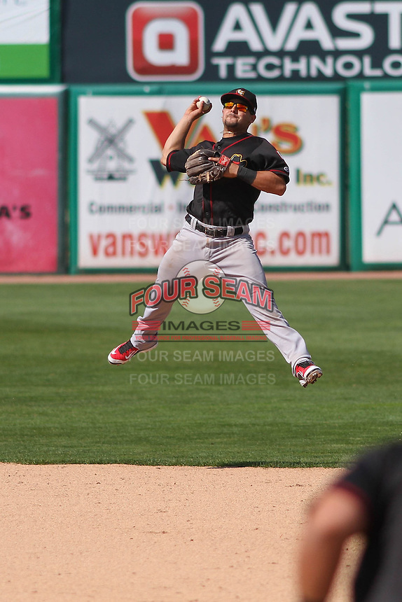 Quad Cities River Bandits second baseman Alex Hernandez (6) jumps in the air to make a throw to first base during a game against the Wisconsin Timber Rattlers on May 2nd, 2015 at Fox Cities Stadium in Appleton, Wisconsin.  Quad Cities defeated Wisconsin 5-2.  (Brad Krause/Four Seam Images)