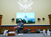 Director of the National Institute for Allergy and Infectious Diseases Dr. Anthony Fauci brings a Washington Nationals face mask when he arrives to testify before the House Committee on Energy and Commerce on the Trump Administration's Response to the COVID-19 Pandemic, on Capitol Hill in Washington, DC on Tuesday, June 23, 2020.    <br /> Credit: Kevin Dietsch / Pool via CNP