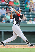 Outfielder Nomar Mazara (12) of the Hickory Crawdads bats in a game against the Greenville Drive on Friday, June 7, 2013, at Fluor Field at the West End in Greenville, South Carolina. Mazara is the No. 16 prospect of the Texas Rangers, according to Baseball America. Greenville won the resumption of this May 22 suspended game, 17-8. (Tom Priddy/Four Seam Images)