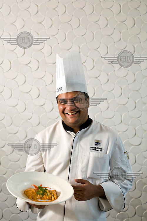 Head chef at the Park Hotel, Anurudh Khanna with a dish of shahi paneer in the restaurant, New Delhi.