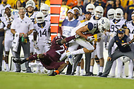 Landover, MD - September 3, 2017: West Virginia Mountaineers wide receiver David Sills V (13) tries to break Virginia Tech Hokies safety Terrell Edmunds (22) tackle during game between Virginia Tech and WVA at  FedEx Field in Landover, MD.  (Photo by Elliott Brown/Media Images International)