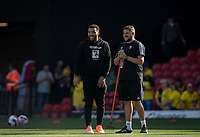 Troy Deeney of Watford and a groundsman pre match during the Premier League match between Watford and Arsenal at Vicarage Road, Watford, England on 16 September 2019. Photo by Andy Rowland.