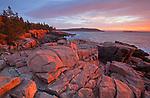 Fiery sunrise along the granite coastline on Ocean Drive/Park Loop Road in Acadia National Park, Maine, USA