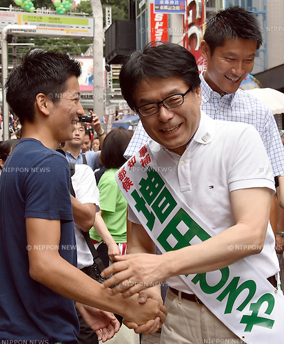 July 17, 2016, Tokyo, Japan - Hirohito Masuda, 64, former internal affairs minister, campaigns for the July 31 Tokyo gubernatorial election in Takeshita Street of Harajuku, ?a?pedestrian?shopping street lined with fashion boutiques, cafes and restaurants?popular among younger generations, on Sunday, July 17, 2016. Contenders took to the street on the first Sunday since campaigning officially started Thursday, appealing voters for their support in the race to fill the vacancy left by the resignation of disgraced former Gov. Yoichi Masuzoe. (Photo by Natsuki Sakai/AFLO) AYF -mis-