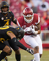 Hawgs Illustrated/BEN GOFF <br /> Devwah Whaley, Arkansas running back, braces for a hit from Kaleb Prewett, Missouri free safety, in the third quarter Friday, Nov. 24, 2017, at Reynolds Razorback Stadium in Fayetteville.