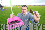 DANGER: Local man, Ristea?rd O? Fuara?in with some of the broken glass which has caused a danger at Ballyheigue GAA field and its environs.