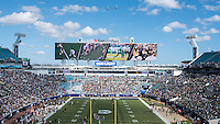Two Navy P-8 Poseidon aircraft fly over EverBank Field during pregame.
