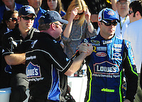Feb 10, 2008; Daytona Beach, FL, USA; Nascar Sprint Cup Series driver Jimmie Johnson (48) is congratulated by a teammate after winning the pole position during qualifying for the Daytona 500 at Daytona International Speedway. Mandatory Credit: Mark J. Rebilas-US PRESSWIRE