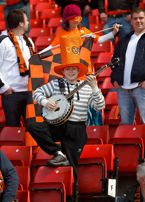 A young banjo playing Dundee Utd fan inside Hampden
