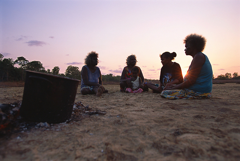 Aurukun women on country, cooking root dye for colouring pandanus fibre, Aurukun, Cape York Peninsula.