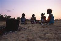 Aurukun women on country, cooking root dye for colouring pandanus fibre, Aurukun, Cape York Peninsula.