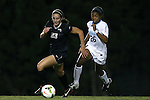 09 October 2014: Wake Forest's Kendall Fischlein (23) and North Carolina's Jewel Christian (26). The University of North Carolina Tar Heels hosted the Wake Forest University Demon Deacons at Fetzer Field in Chapel Hill, NC in a 2014 NCAA Division I Women's Soccer match. UNC won the game 3-0.