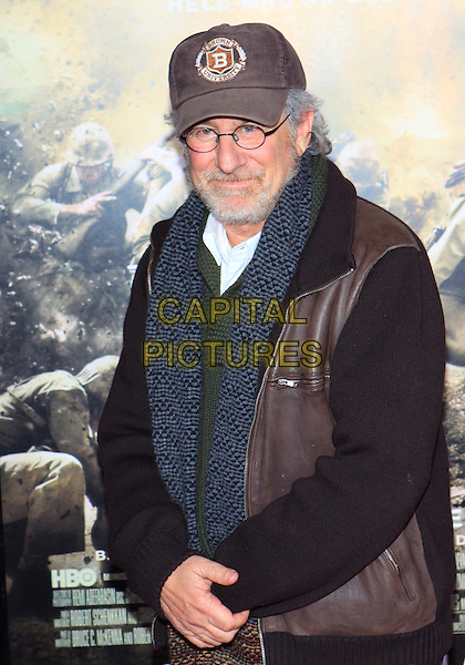 "STEVEN SPEILBERG.Attending the Los Angeles Premiere of HBO's ""The Pacific"" held at Grauman's Chinese Theater, Hollywood, California, USA, 24th February 2010 .half length leather jacket brown cap hat beard facial hair glasses scarf knitted green grey gray .CAP/ADM/TC.©T. Conrad/AdMedia/Capital Pictures."