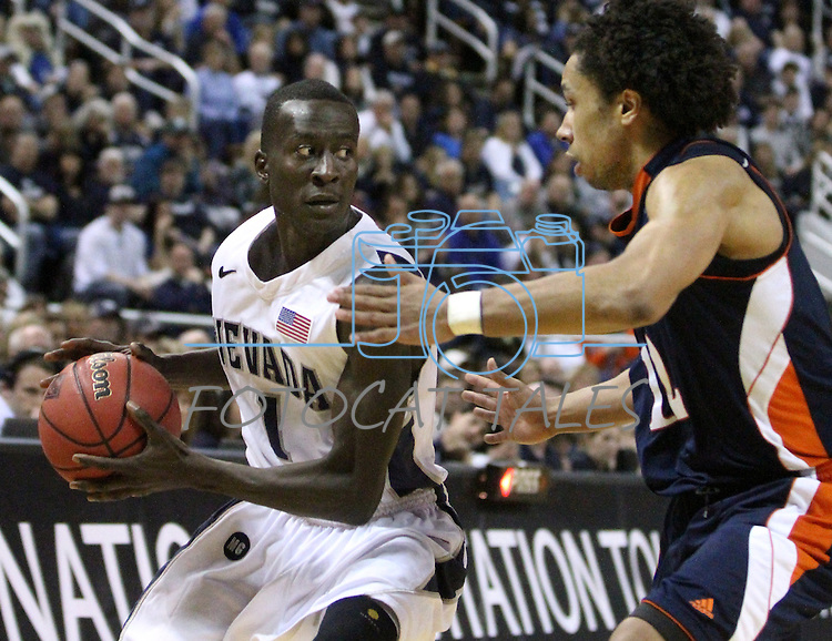 Nevada's Patrick Nyeko looks around Bucknell defender Bryson Johnson during a second round NIT college basketball game in Reno, Nev. , on Sunday, March 18, 2012. Nevada won 75-67..Photo by Cathleen Allison