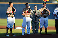 Quad Cities River Bandits third baseman Rio Ruiz #8, pitcher Lance McCullers #23 and first baseman Miles Hamblin #15 during the national anthem before a game against the Wisconsin Timber Rattlers on May 24, 2013 at Modern Woodmen Park in Davenport, Iowa.  Quad Cities defeated Wisconsin 4-3  (Mike Janes/Four Seam Images)