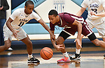Collinsville guard Cawhan Smith (left) and Belleville West guard Tommie Williams vie for a loose ball. Belleville West played Collinsville in the Class 4A Belleville East regional basketball championship game at Belleville East High School in Belleville, Illinois on Friday March 6, 2020. <br /> Tim Vizer/Special to STLhighschoolsports.com